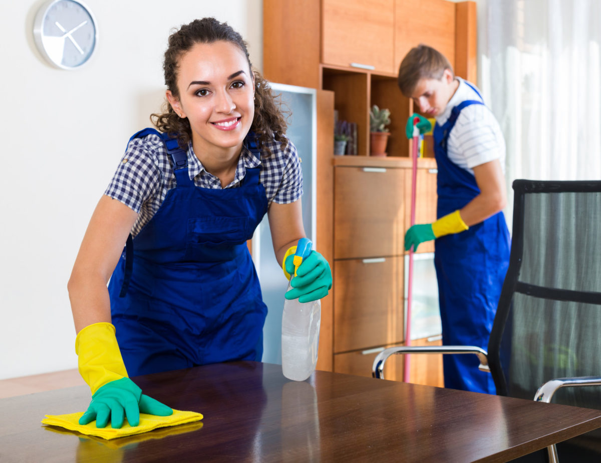 woman in uniform cleaning
