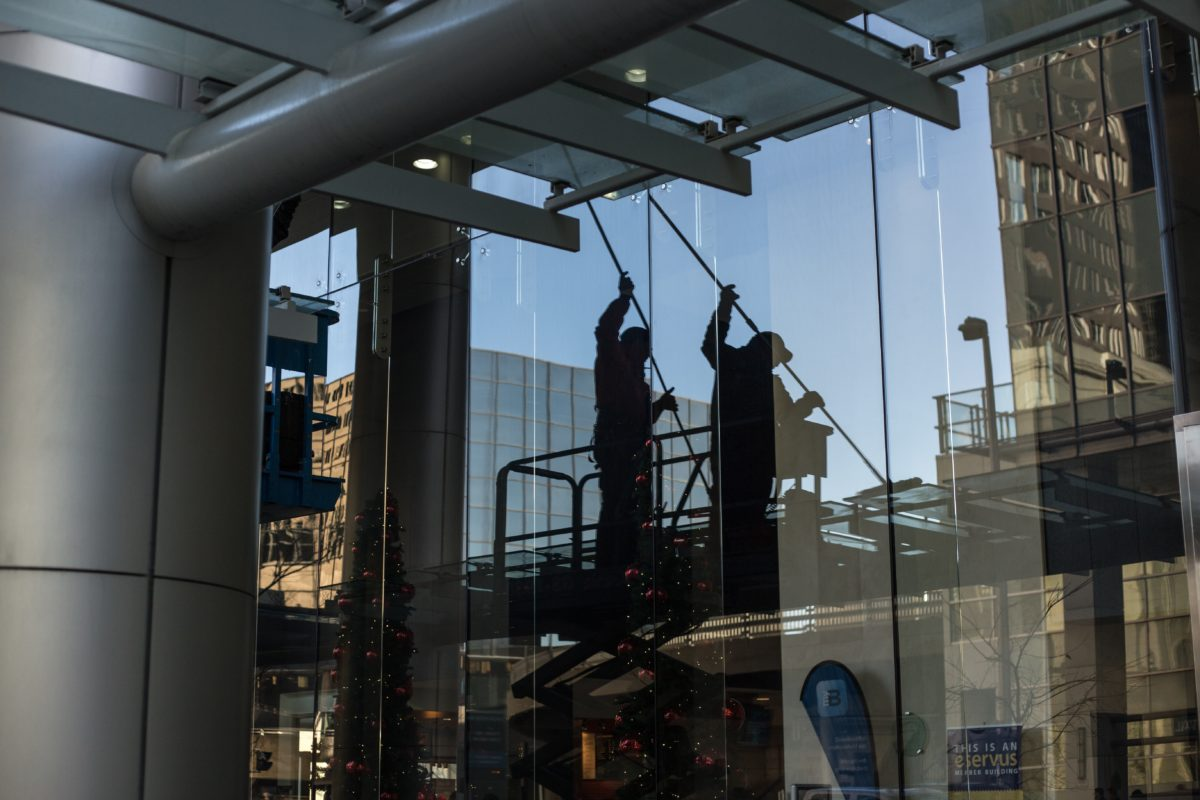 people cleaning commercial building windows